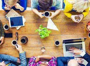 Group of associates discuss starting a business