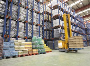 A warehouse full of inventory being tracked by inventory management software.