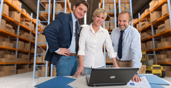 Business associates smile because they chose the right inventory management software for their business