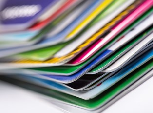 A pile of credit cards being consolidated into one payment.
