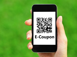 An E-coupon reader pulled up on a smartphone as a woman uses coupon secrets to save money.