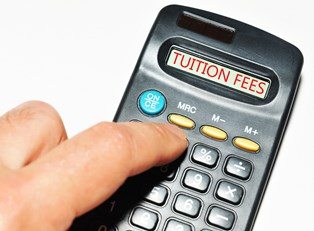A calculator screen reading TUITION FEES as a student calculates how to pay for college through scholarships.