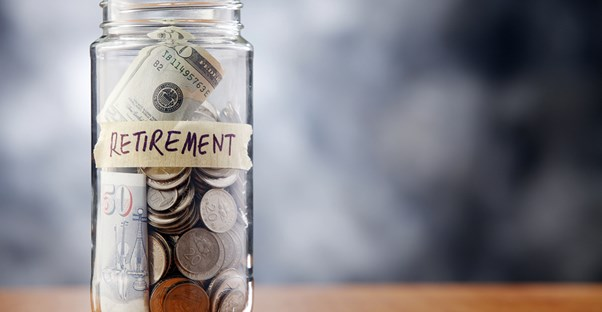 A jar labeled RETIREMENT holding spare change  to represent a reason you need a financial adviser.