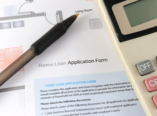 A home loan application sitting on the desk of a home buyer.