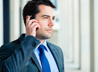 A business owner talks to his business phone service to guarantee he is getting the most out of his service.