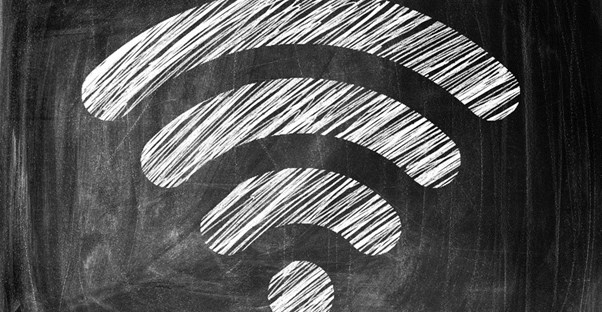 A wifi symbol drawn on a chalkboard to represent an internet speed.