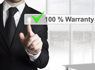 A man touches the 100 percent warranty button on a touchscreen.