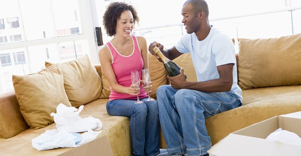 Couple Celebrating Successful Home Purchase