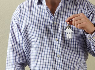 Man in Gingham Shirt With Key