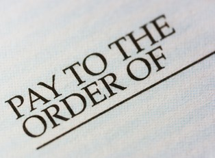 A close up of pay to the order of representing the personal security of check or money orders