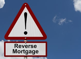 Sign that says reverse mortgage with an exclamation point