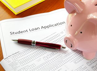 Piggy Bank filling out a student loan application