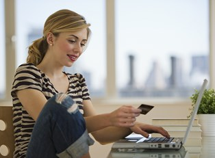 Woman shopping with her secured credit cards