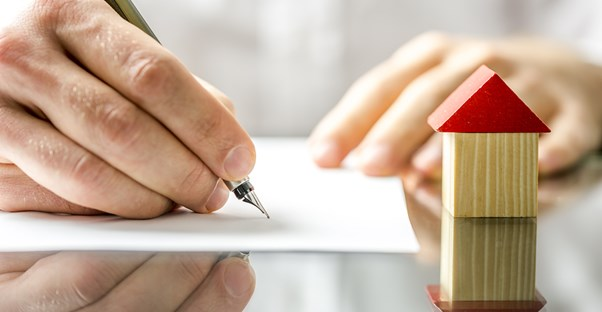 Person filling out an application for a home equity loan