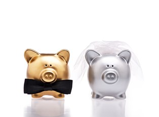 Two piggy banks dressed up for a wedding