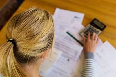 Woman adding up her expenses and income now that she is unemployed
