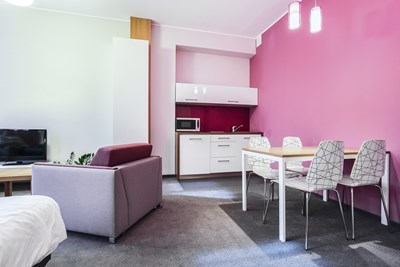 Pink walled studio apartment